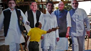 A worker cleans a cut-out of Gandhi India's ruling Congress party Vice President as they are put on display for sale ahead of general elections in Ghaziabad